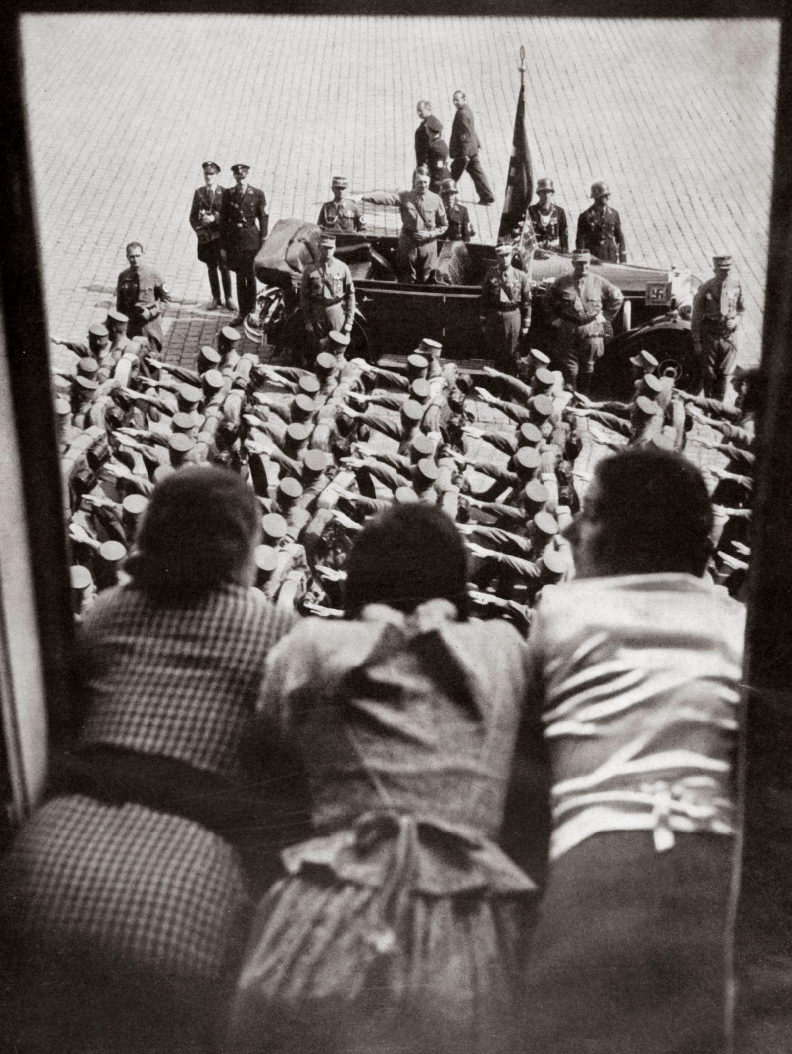 Three Girls Watching The Traditional Parade Of SA Stormtroopers Nuremberg Germany circa 1923-1938