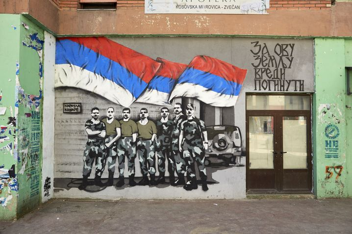 A mural glorifying Serbian fighters on the Serbian side of Mitrovica bridge