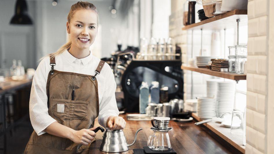 Barista in einem Café