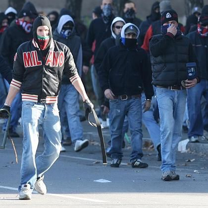 Milan fans in Bergamo on Sunday. The scourge of fan violence reared its ugly head again this weekend.