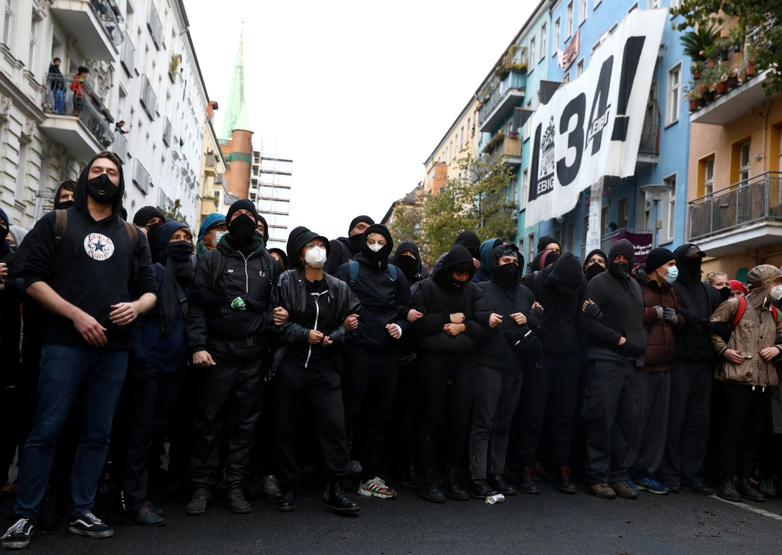 Demonstrators protest by the squatted left-wing housing project Liebigstrasse 34, which faces eviction by the police in Berlin