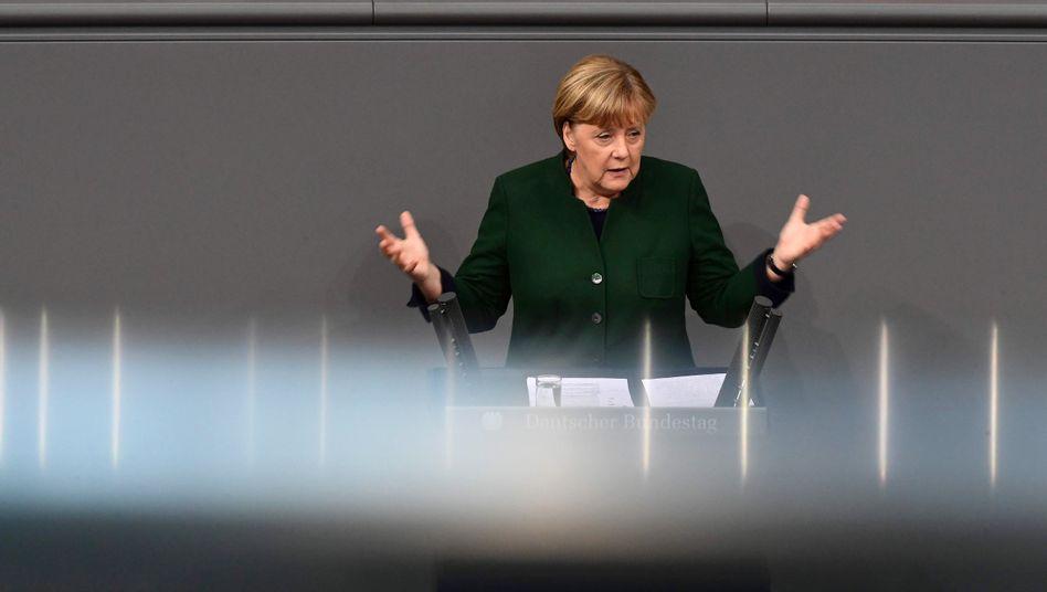 Generaldebatte im Bundestag: Merkel will weiter mitErdogan kooperieren