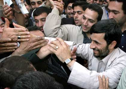 Ahmadinejad shakes hand with supporters after Friday prayer ceremonies in Tehran on October 28. He has styled himself as a down-to-earth man of the people.