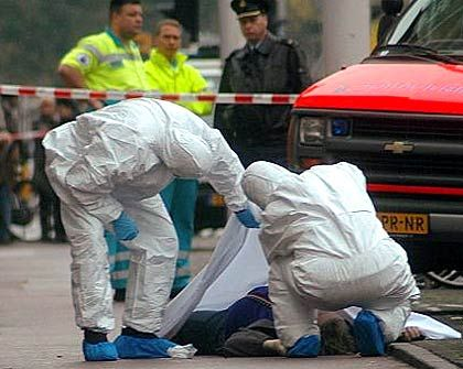Police at the scene of Dutch filmmaker Theo van Gogh's murder.