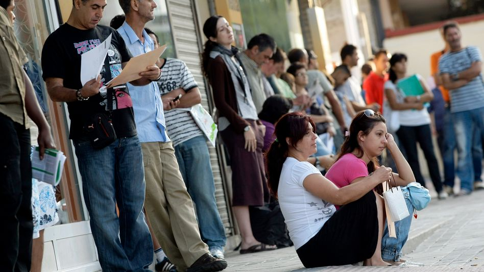 People lined up in front of an unemployment center in Madrid.