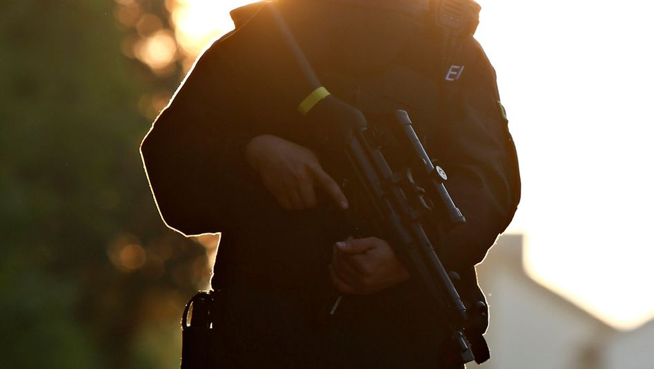 A special police force officer in Ansbach: Fear has become the driving political force in Germany after attacks.