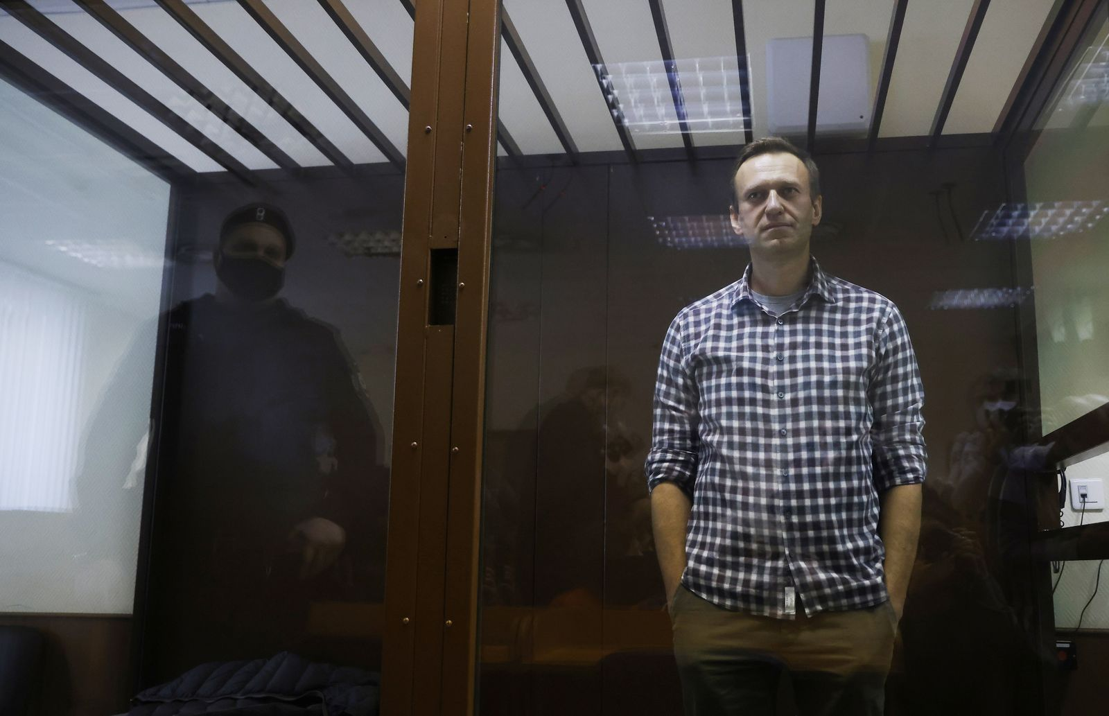 Russian opposition leader Alexei Navalny hearing to consider an appeal against an earlier court decision to change his suspended sentence to a real prison term