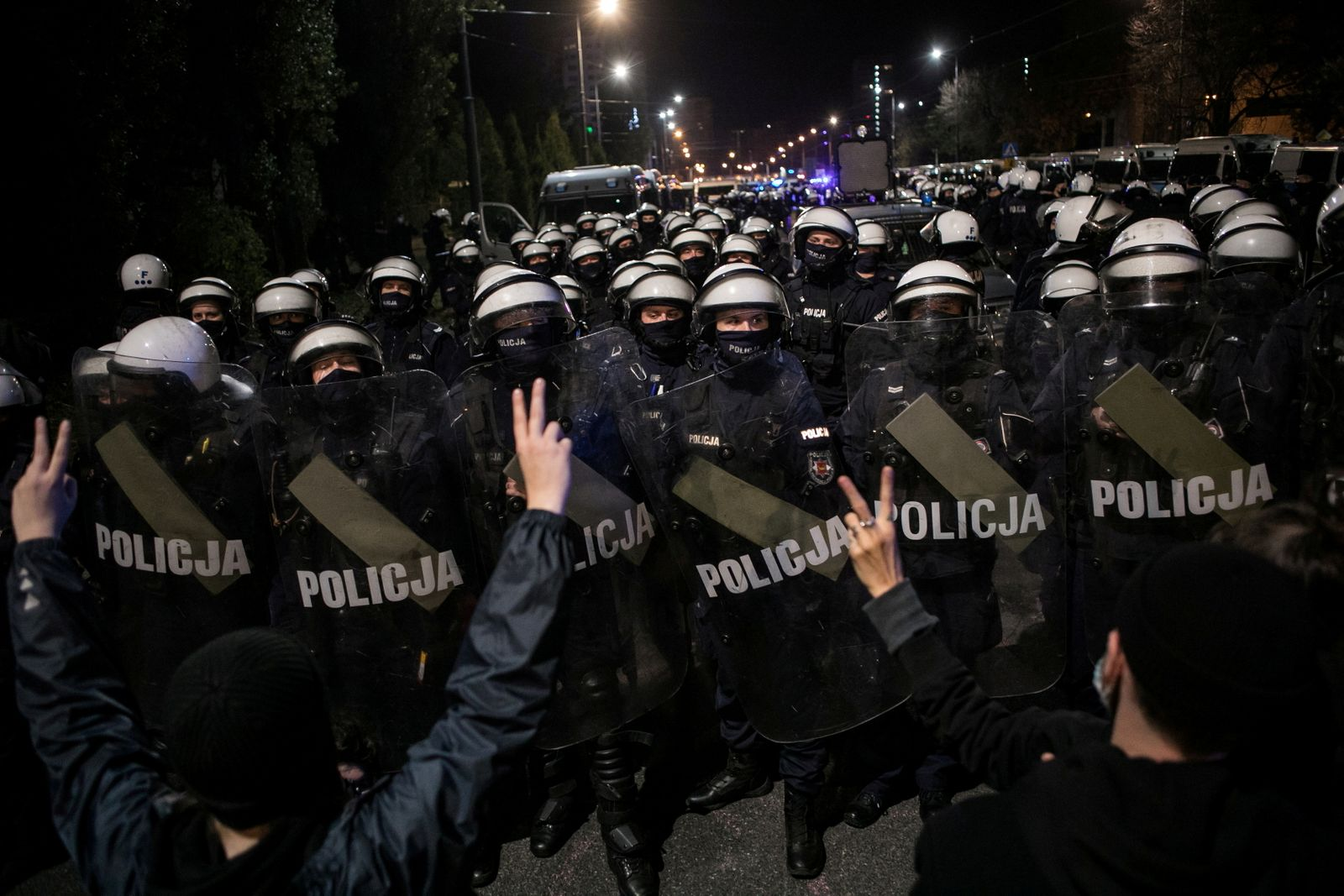 Police block a street near the house of Law and Justice leader Jaroslaw Kaczynski during a protest against imposing further restrictions on abortion law in Warsaw