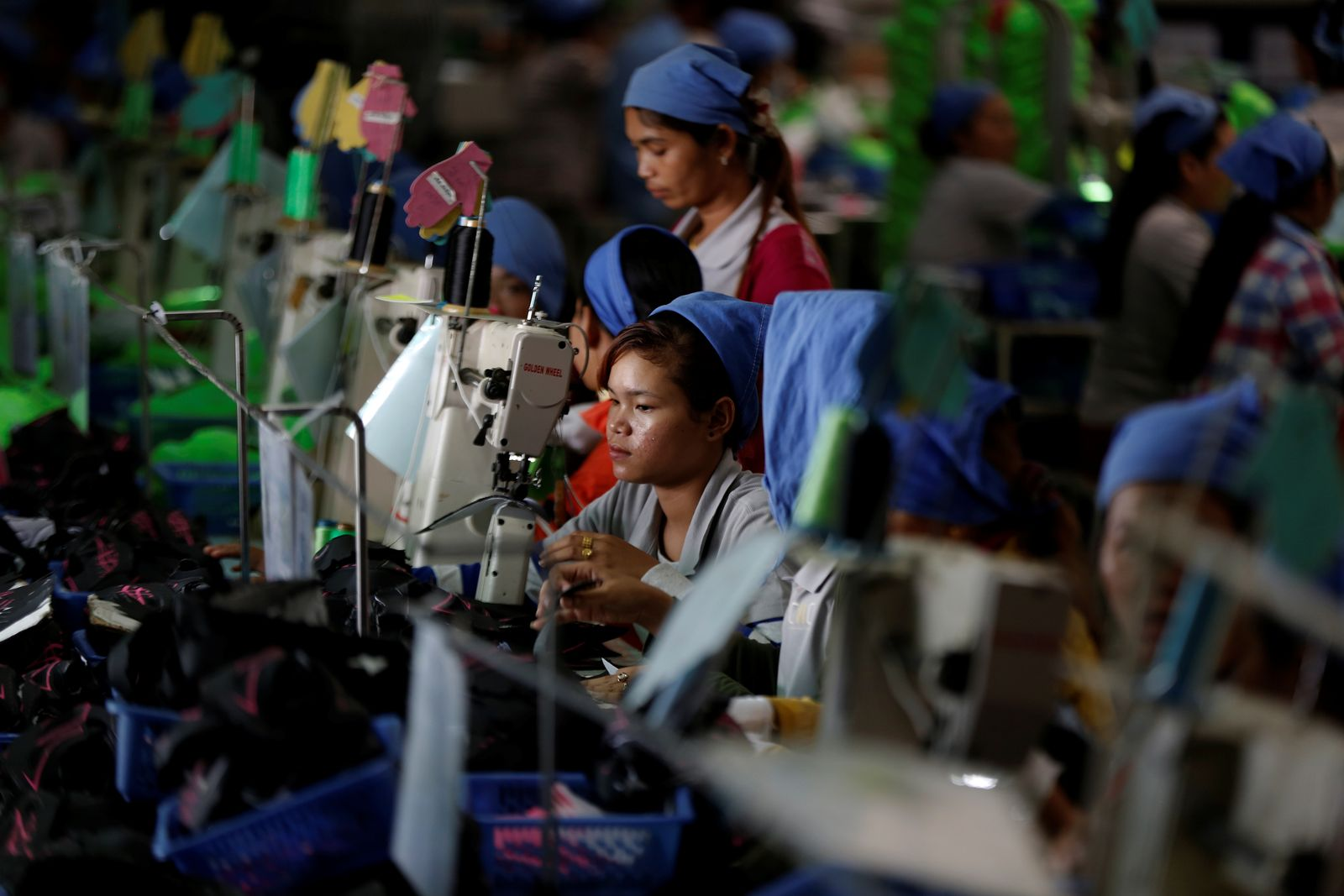 The Wider Image: Cambodian shoe maker has little time for politics