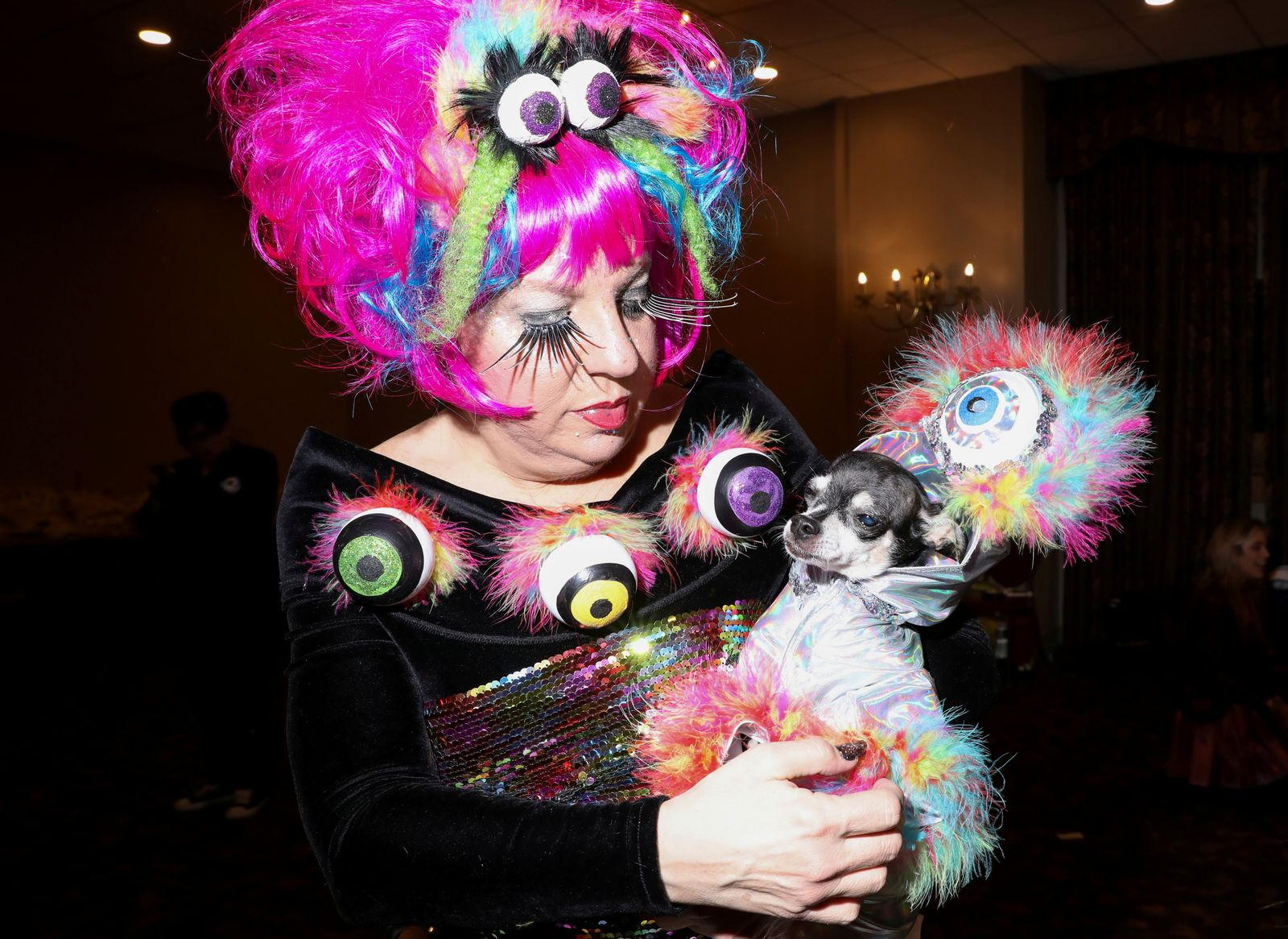 A woman holds dog at the 17th annual New York Pet Fashion Show in New York