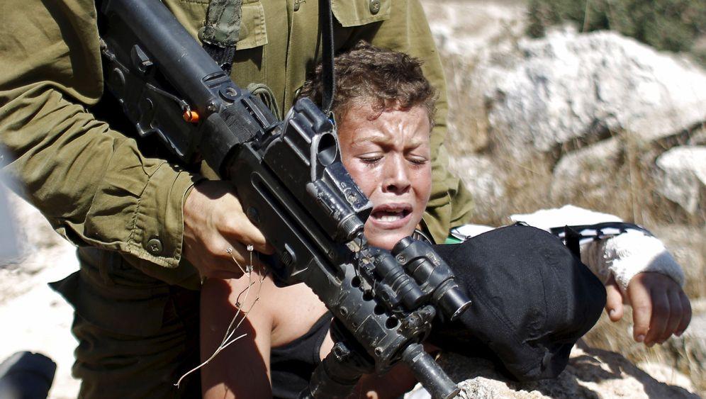Fotostrecke: Kind gegen Soldat