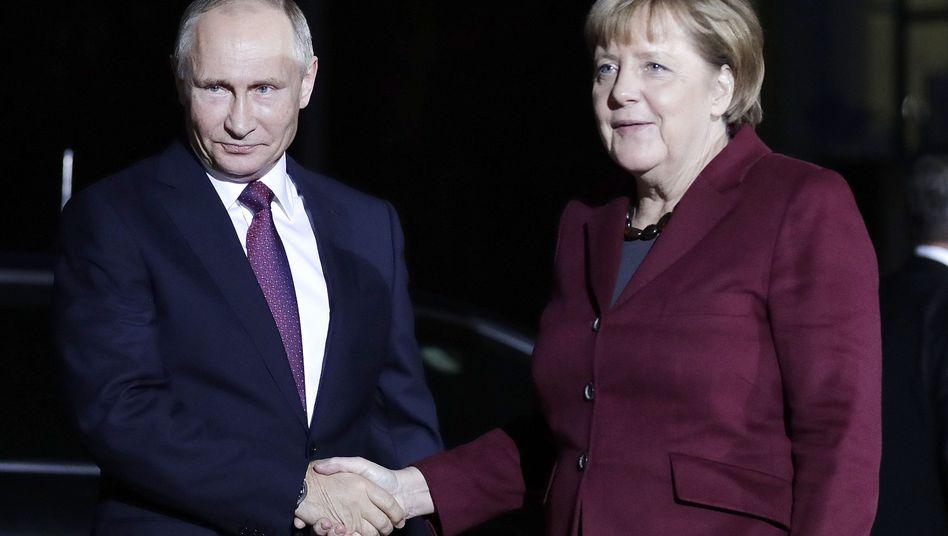 Putin und Merkel in Berlin