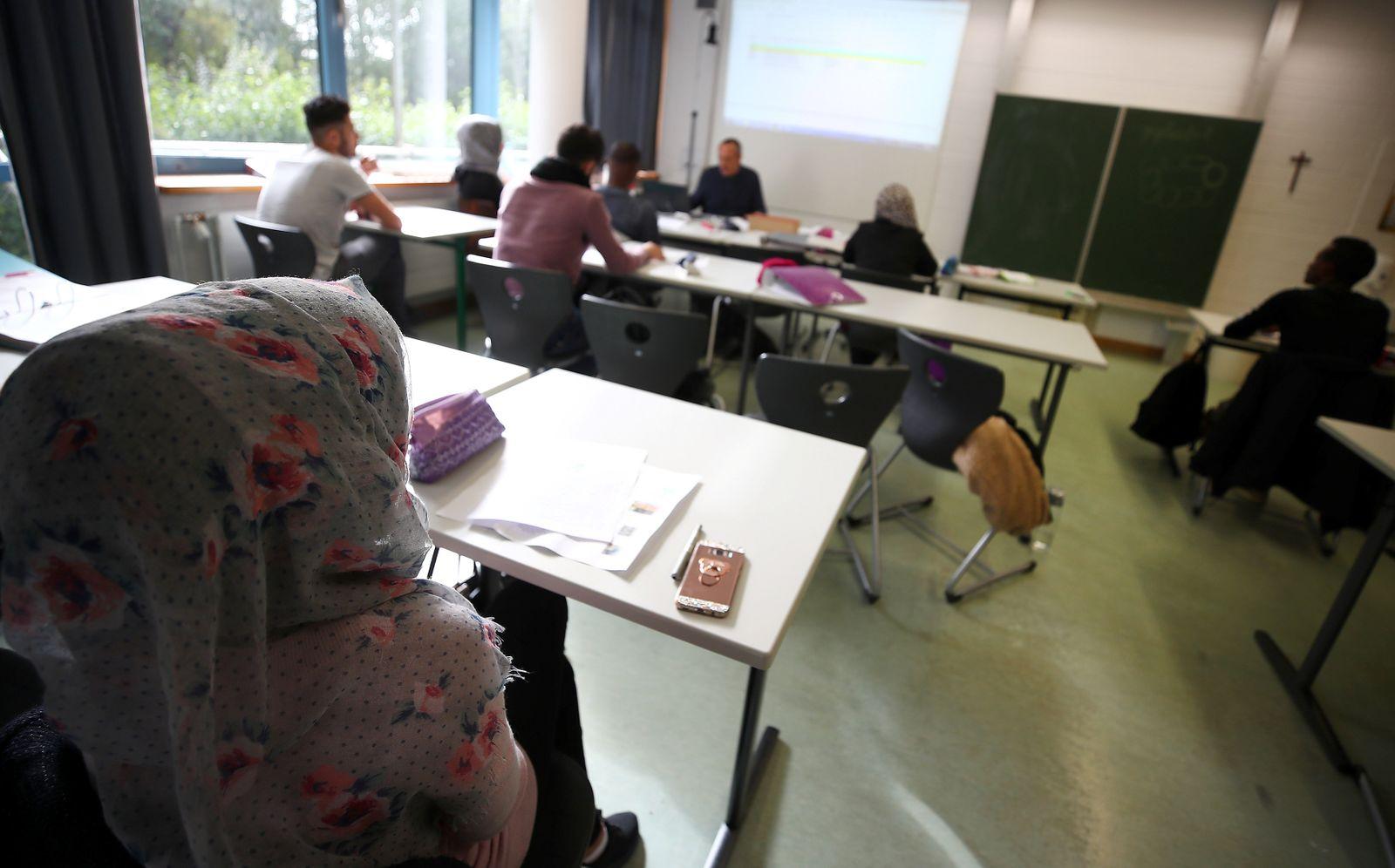 Students sit in a classroom of the Europa-Berufsschule vocational school in Weiden