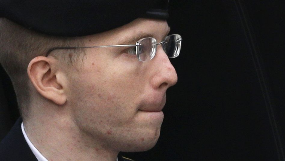 Bradley Manning is escorted into a courthouse in Fort Meade, Maryland on Aug. 21, 2013, before his sentencing.