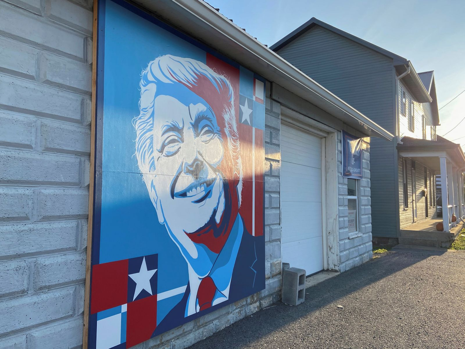 A mural of a smiling U.S. President Donald Trump commissioned by Randy Bunch, a commissioner in Fulton County, is seen on the side of a business on Election Day in McConnellsburg, Pennsylvania