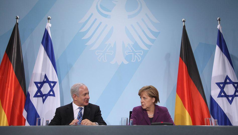 Netanyahu and Merkel during a meeting in Berlin in 2011. Rarely have Israeli-German relations been as tense as they are this week.