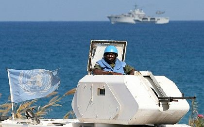 Can UNIFIL prevent Hezbollah from smuggling arms into Lebanon by sea? Here, a Ghanian peacekeeper with an Italian ship in the distance.
