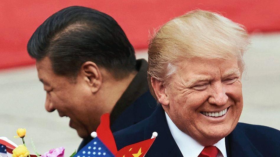 Kontrahenten Xi, Trump in Peking im November 2017:Ein Schaden von 3,6 Billionen Euro