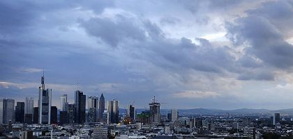 Storm clouds gather over Frankfurt, Germany's banking center.