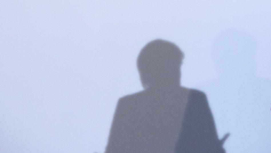 Schatten von Angela Merkel