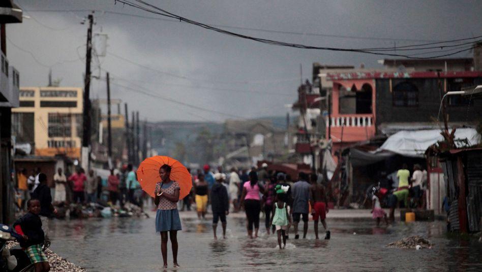 """Überflutete Straßen durch Hurrikan """"Matthew"""" in Haiti im Oktober 2016"""