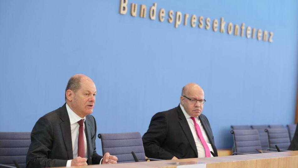 Finanzminister Olaf Scholz (l.) und Wirtschaftsminister Peter Altmaier: Kampf gegen die Krise