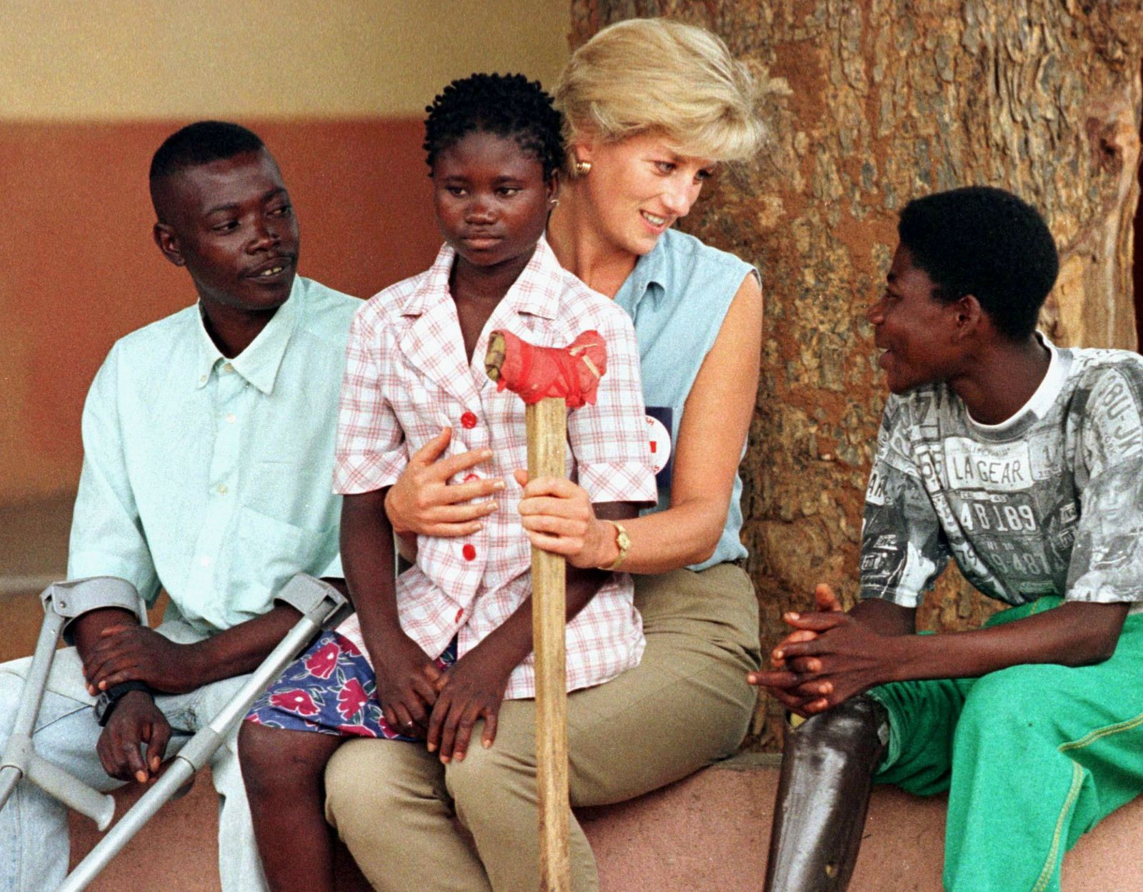 Diana, Princess of Wales, on a four day visit to Angola talks to disabled former government soldiers..