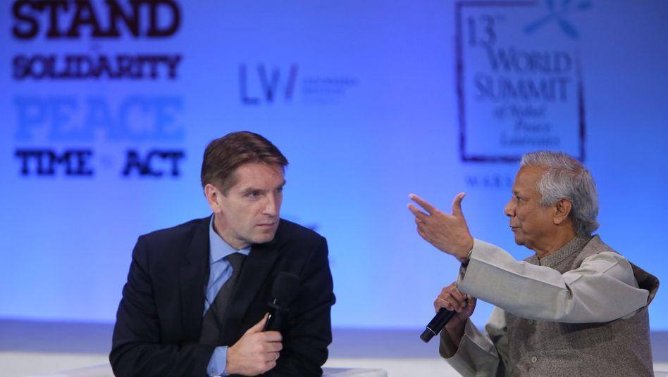 Verliert seine Talkshow: Tomasz Lis (hier im Gespräch mit Mohammad Yunus)