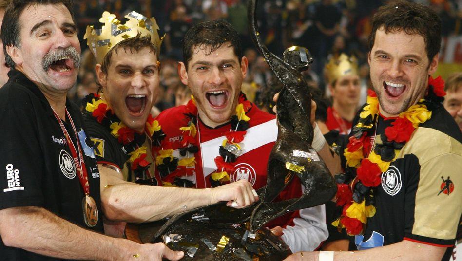 Heiner Brand, Michael Kraus, Henning Fritz and Markus Baur beim WM-Sieg 2007 (von links nach rechts)