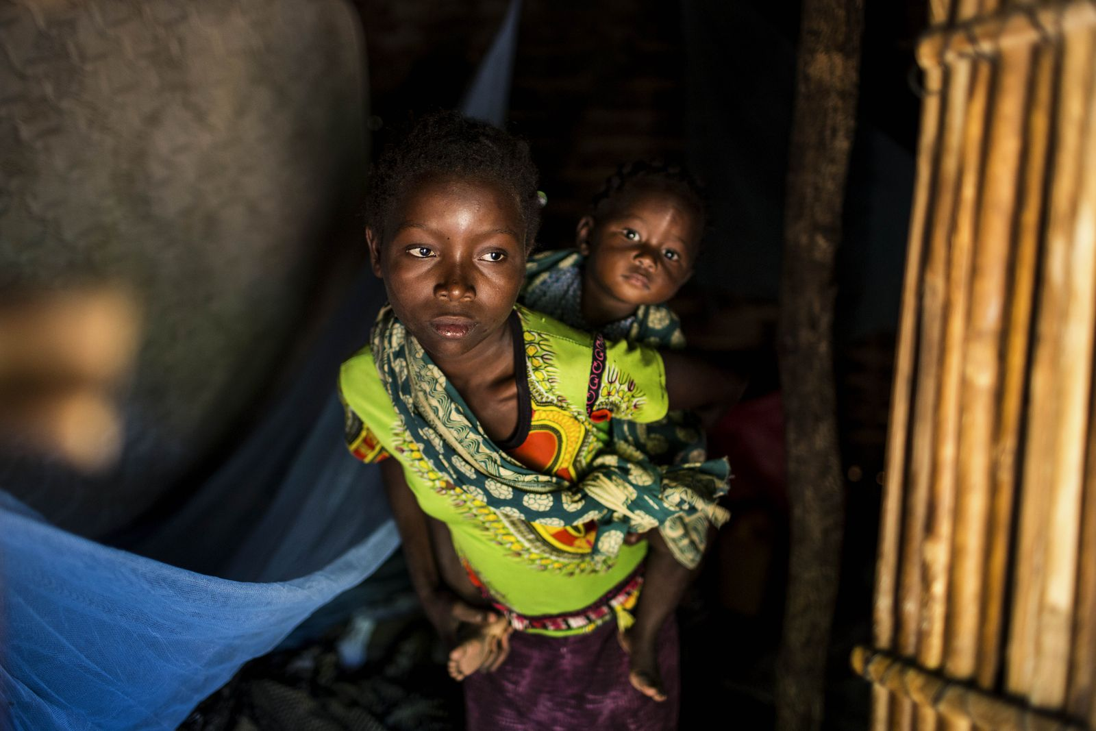 Family flees from the violence in Cabo Delgado province, Pemba, Mozambique - 22 Jul 2020