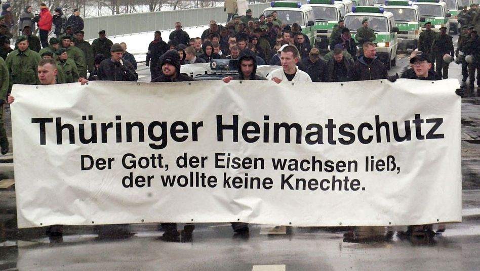 Neo-Nazis carry a banner for the far-right group Thüringer Heimatschutz in a 2001 demonstration in Jena. The files that were destroyed were related to the group.