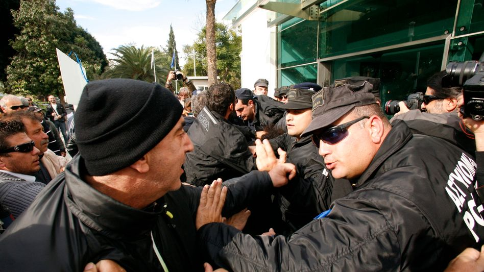 Anti-austerity demonstrators clash with security personnel in Cyprus in December.