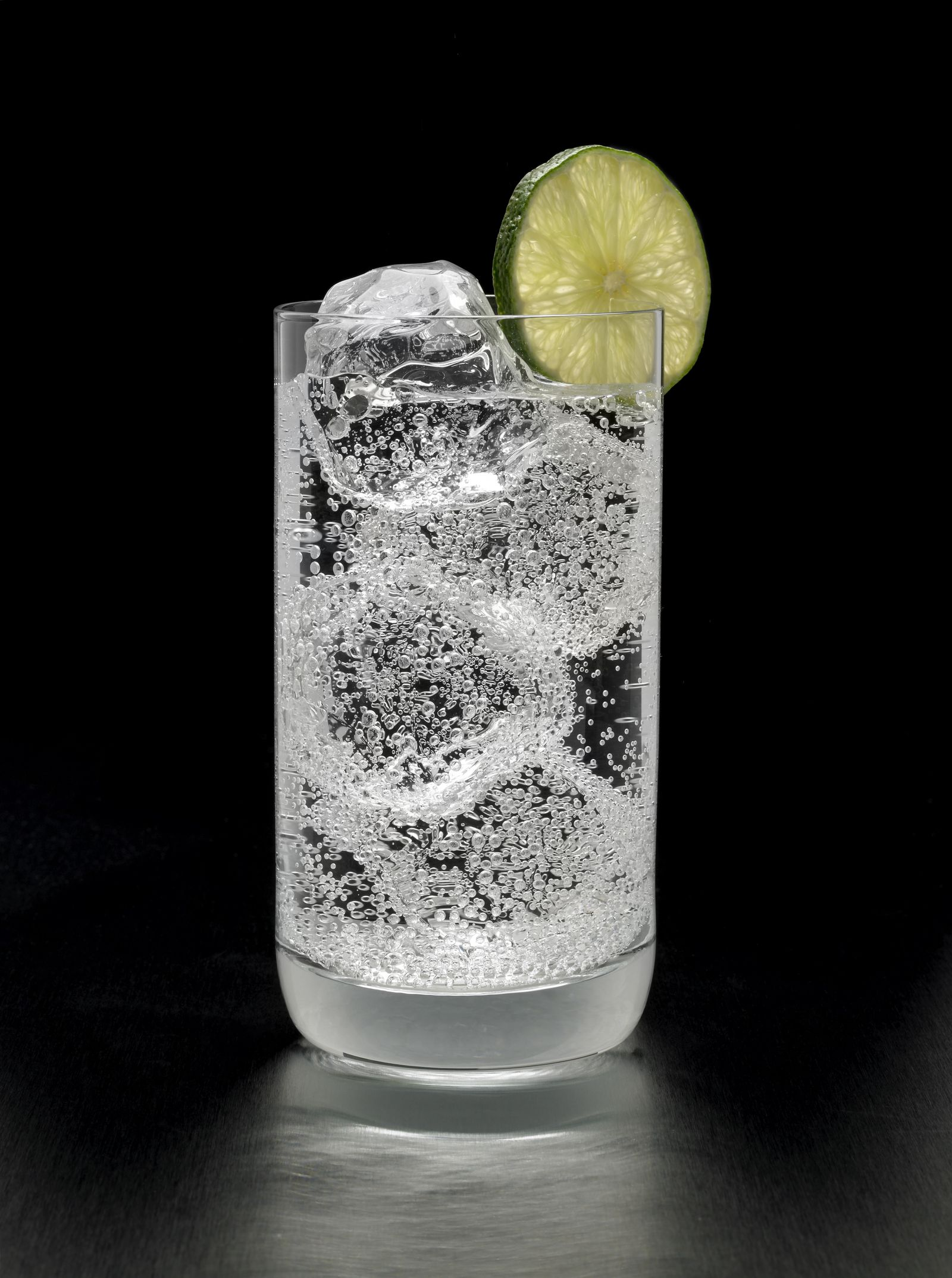 Gin and Tonic Cocktail on black background