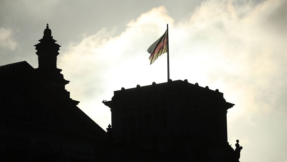 A flag flies over the Reichstag in Berlin, the seat of German parliament.