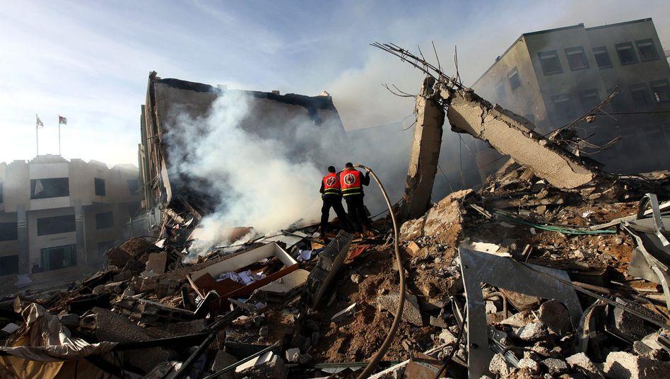 Zerstörte Gebäude in Gaza-Stadt: Recht und die Pflicht, Bevölkerung zu schützen
