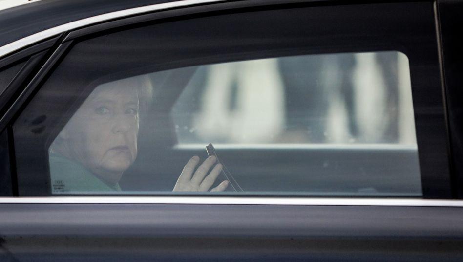 Angela Merkel an Bord eines Dienstwagens