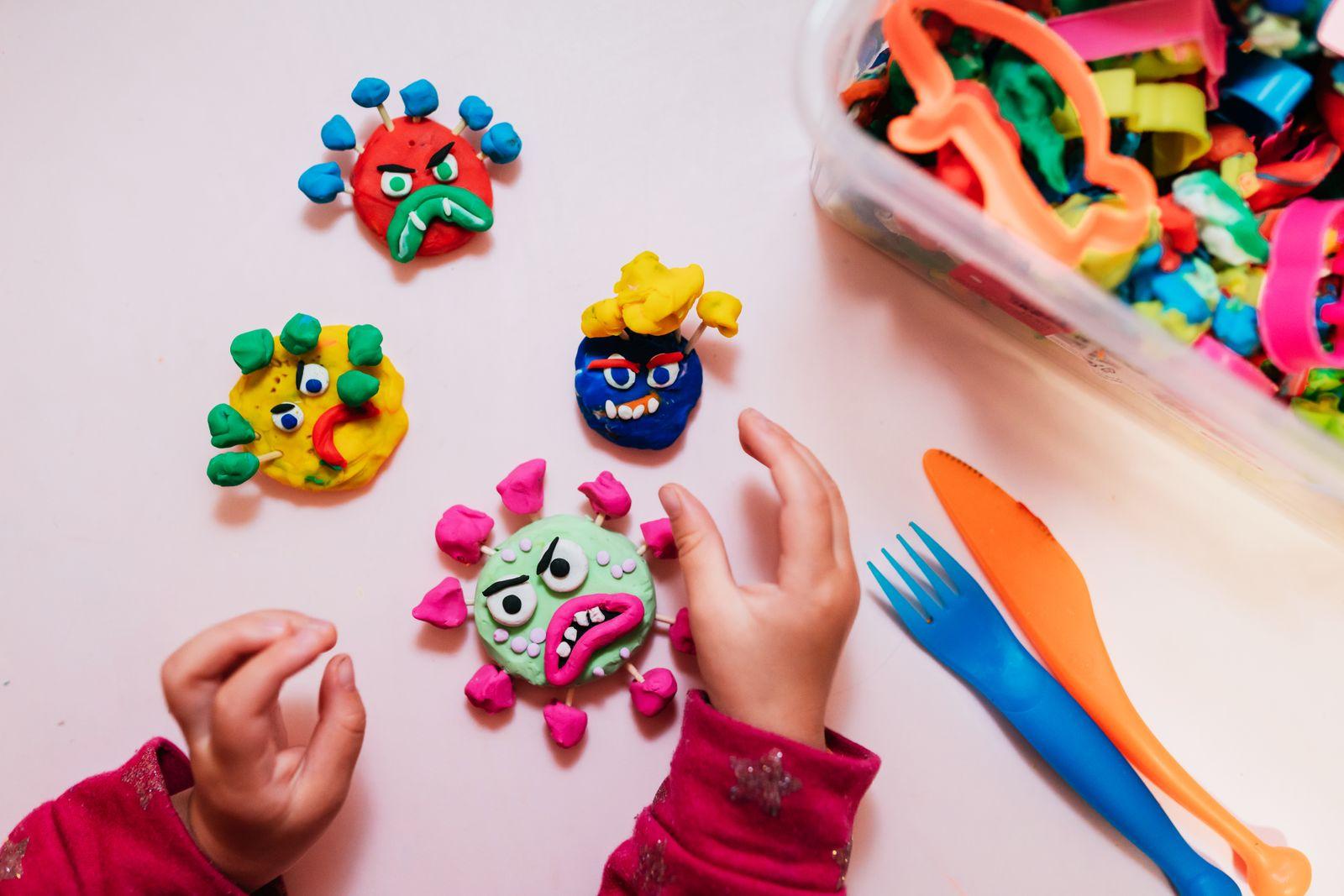 Kid handmade coronavirus ugly monsters made with plasticine