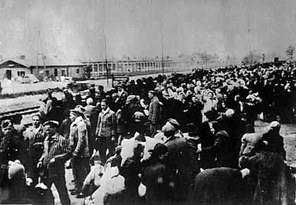 A train-load of victims destined for Auschwitz concentration camp, lined up on the railway station on arrival at Auschwitz.