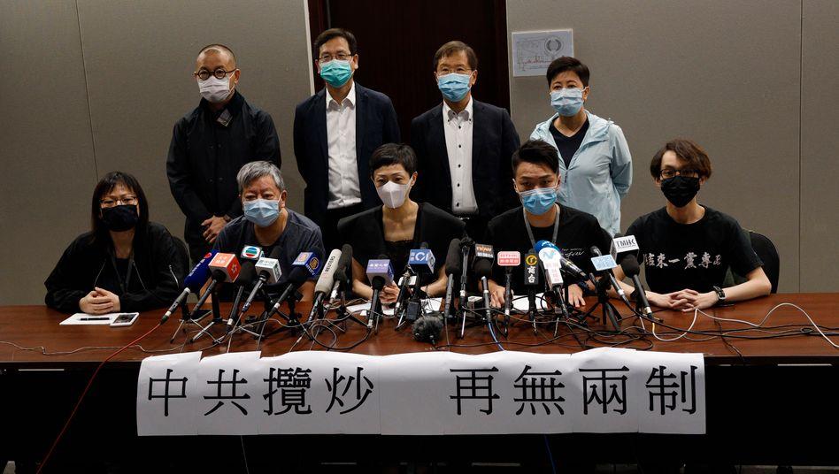 Menschenrechtsaktivisten in Hongkong bei einer Pressekonferenz: Viele haben Angst vor China