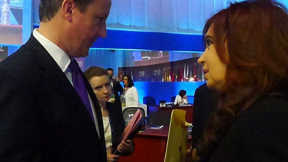 Politiker Cameron, Kirchner: Streit um Umschlag in Mexiko