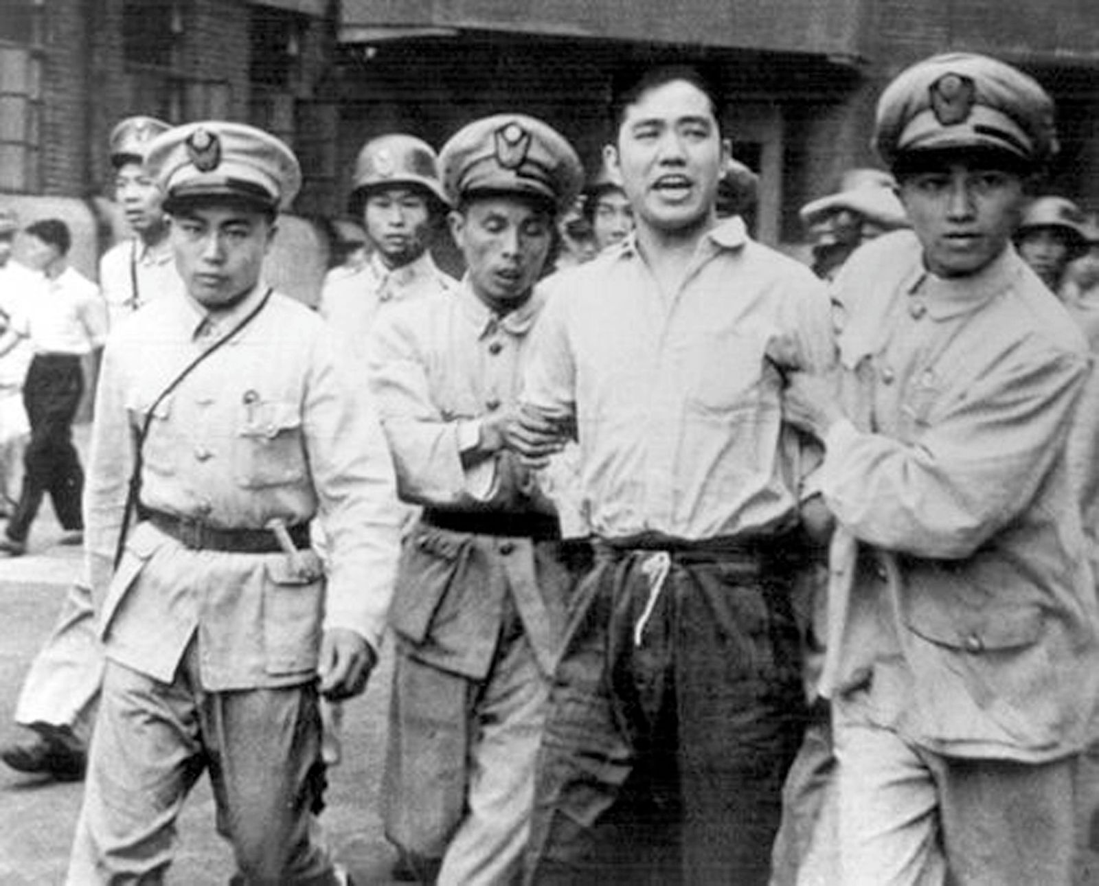 China: Wang Xiaohe (1924-1948) arrested and led away by Kuomintang security forces in Shanghai, 30 September, 1948. He w