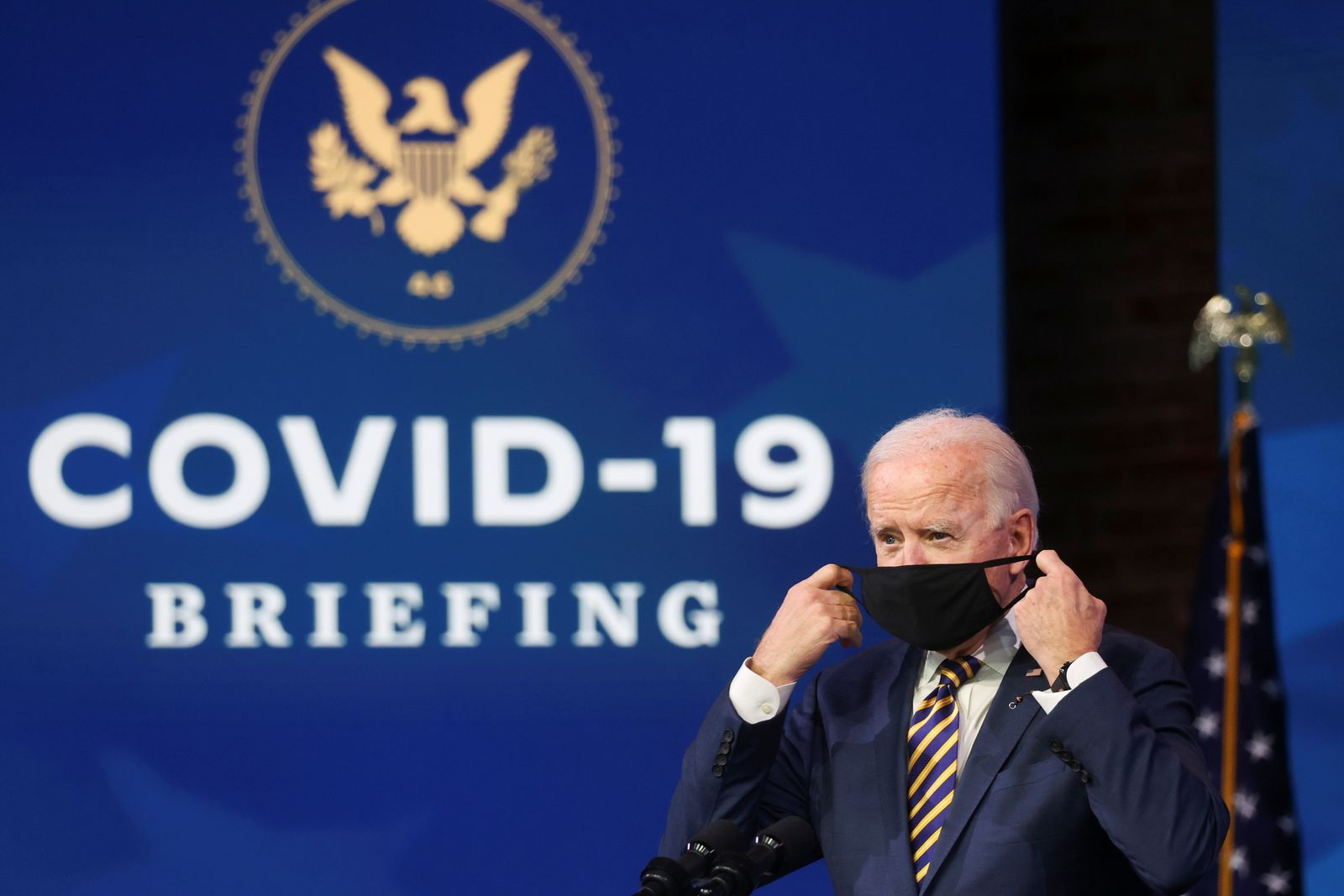 U.S. President-elect Joe Biden delivers remarks on the U.S. response to the coronavirus disease (COVID-19) outbreak, at his transition headquarters in Wilmington