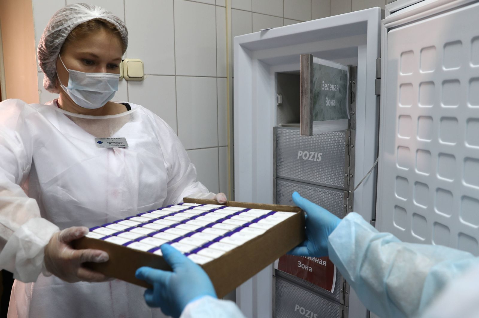 MOSCOW, RUSSIA - SEPTEMBER 4, 2020: Medical staff with newly delivered boxes containing COVID-19 vaccine in a cold room