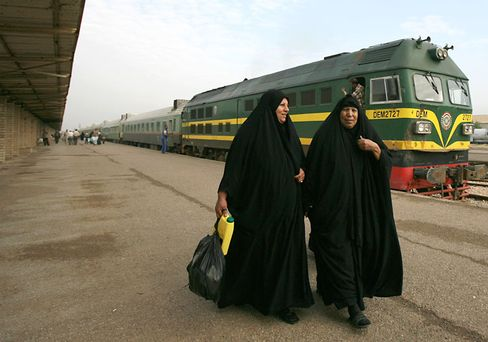 Iraqi train passengers leave a station in Baghdad.
