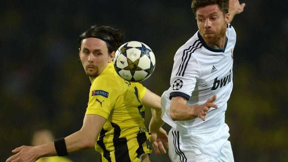 Madrid-Profi Alonso (r.), BVB-Profi Subotic (Archiv): Drei Monate Pause