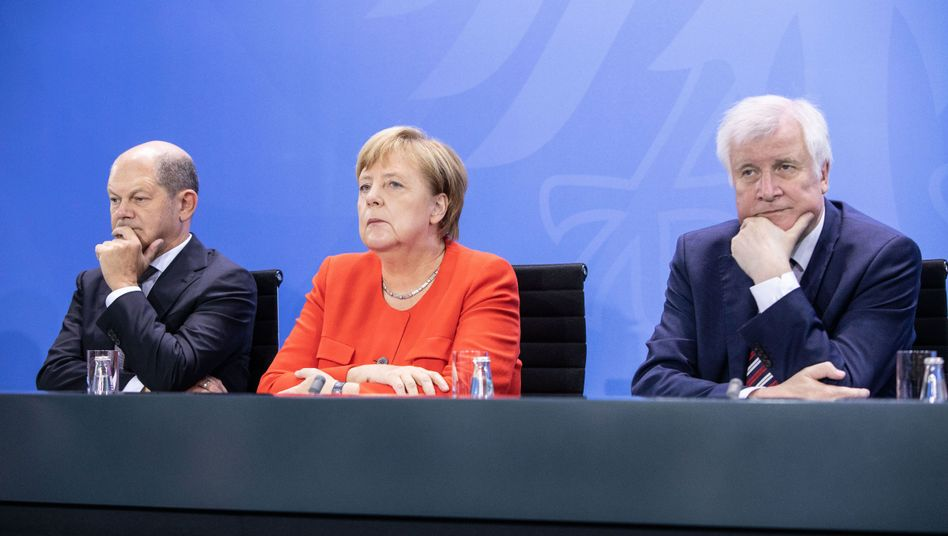Olaf Scholz (links), Angela Merkel, Horst Seehofer