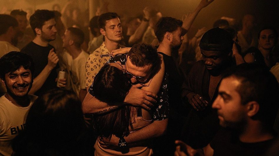 """Revellers at a London nightclub on """"Freedom Day"""": """"We now have wings – these are the vaccines. But are the wings also strong enough to carry us and keep us from falling?"""""""