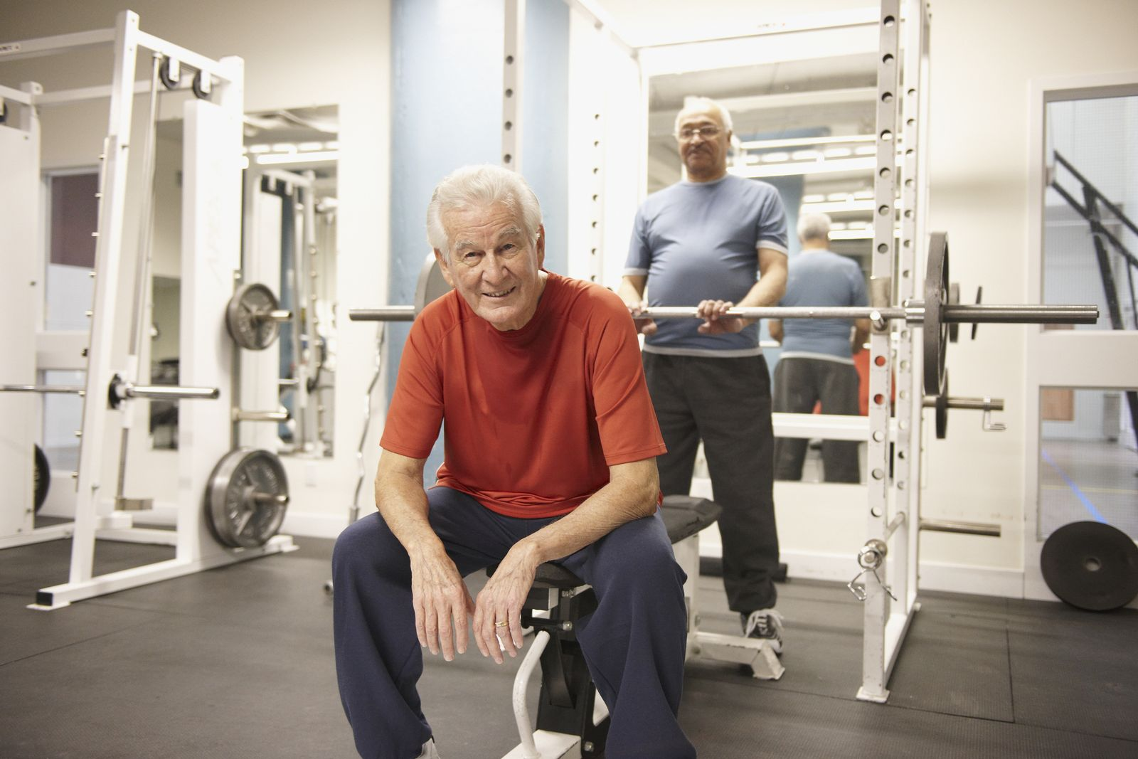 Senior men working out in health club