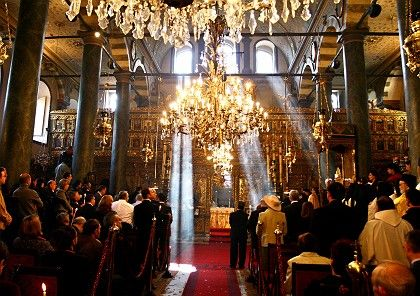 Orthodox worshippers attend a morning mass at the Patriarchal Cathedral of St. George in Istanbul.