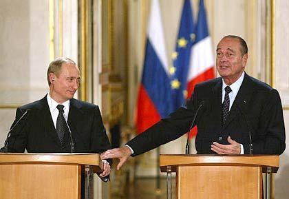 Njet mit Hintertürchen: Putin beim Staatsbesuch in Paris mit Präsident Chirac